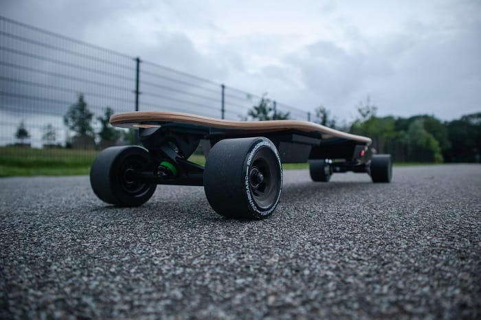electric skateboard photograph in a road